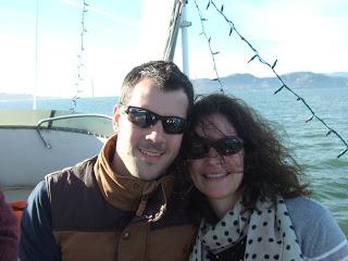 Photo of Rebecca & Simon aboard a boat in San Francisco bay
