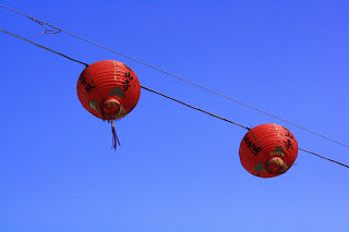 Photo of Chinese lanterns against blue sky