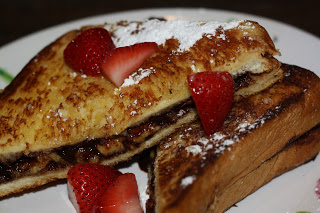 Photo of nutella and banana toasted sandwich with strawberries