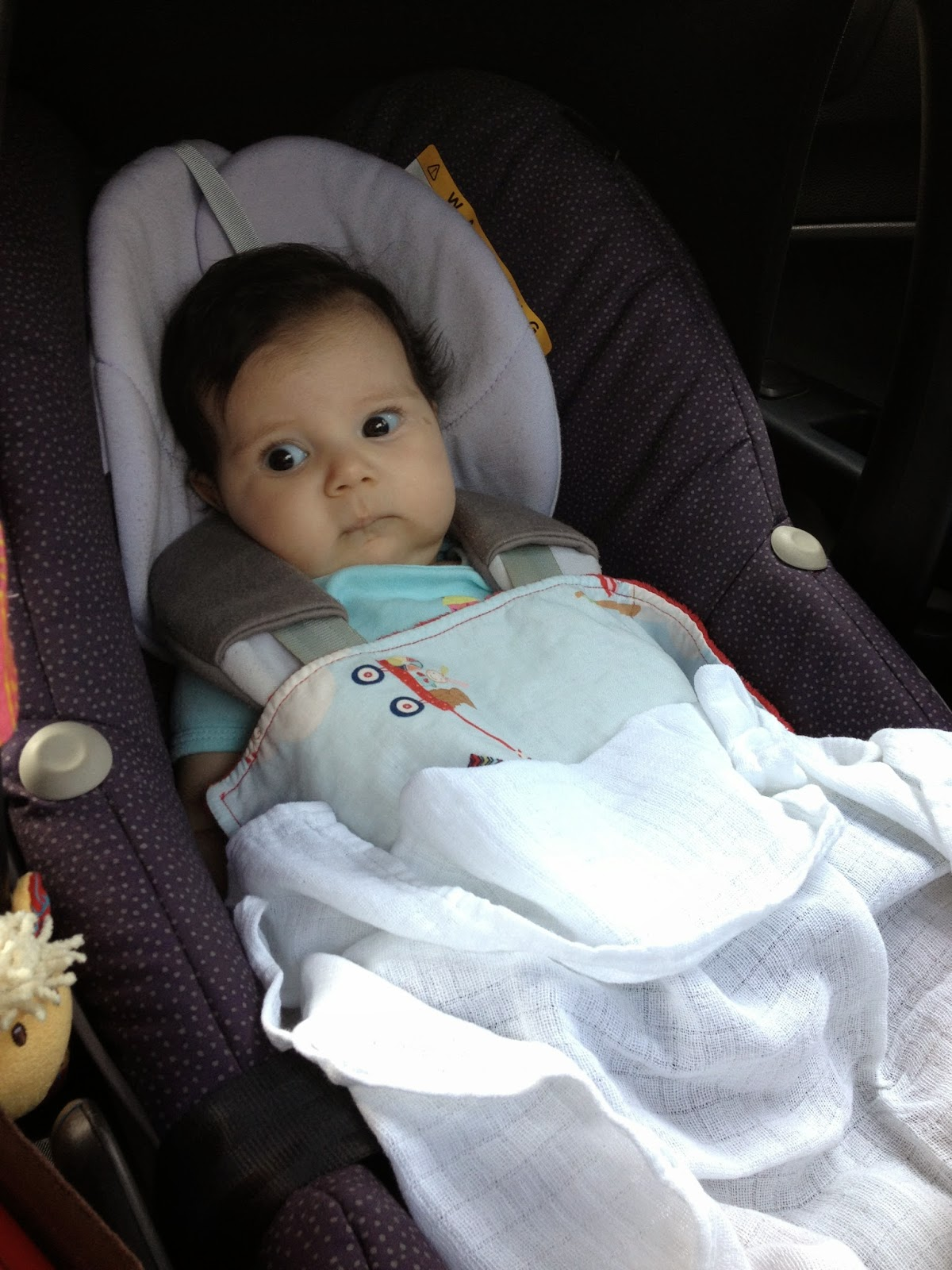 Photo of Miss H in her car seat on the way to Baguio