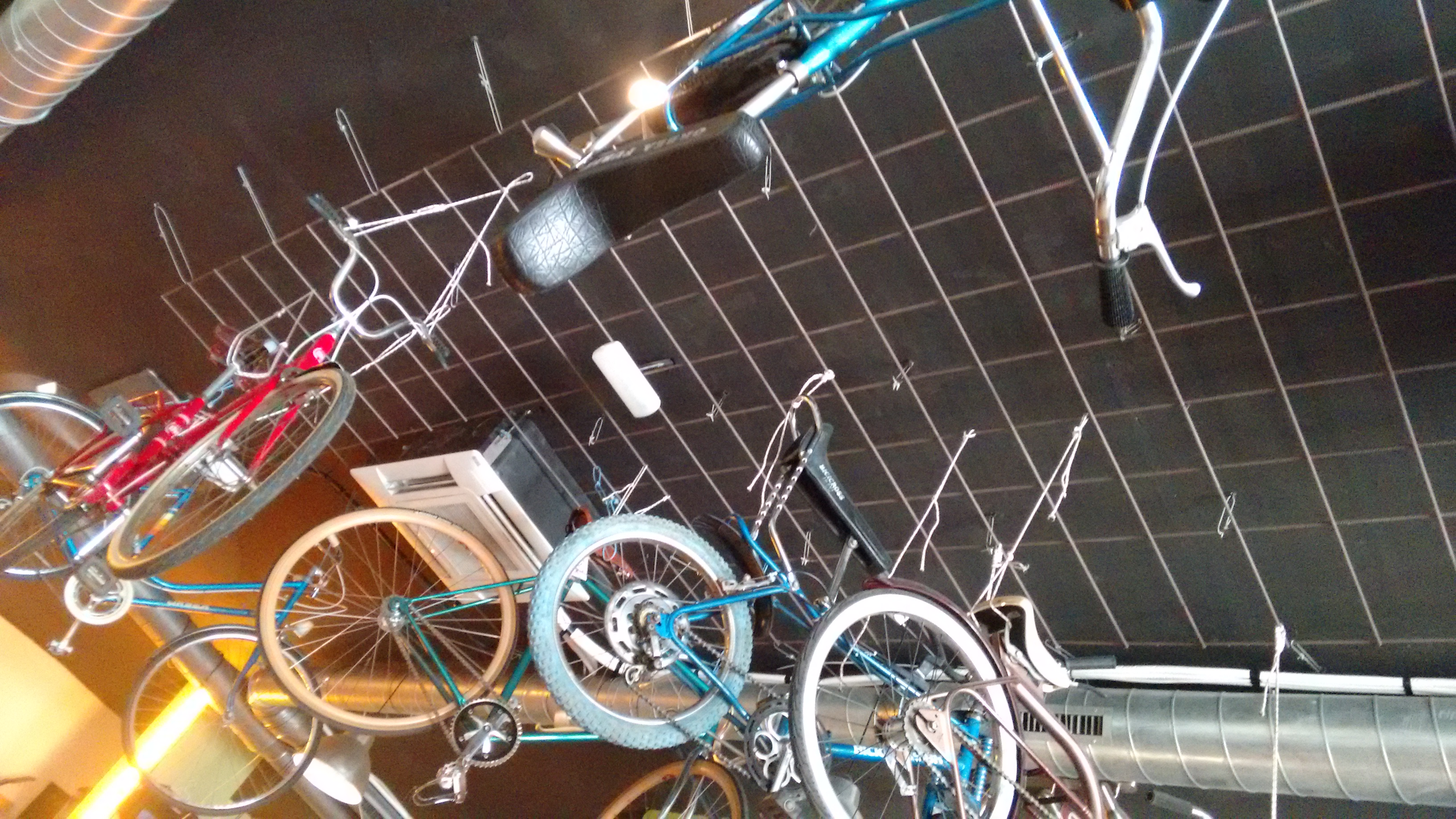 Photo of bikes on the ceiling in Recyclo cafe