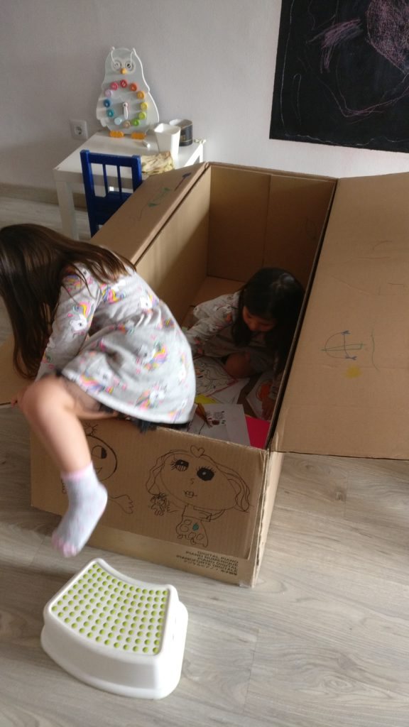 children playing in a box