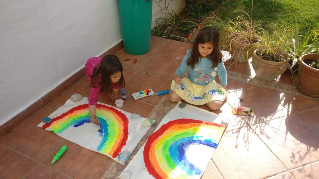 children painting rainbows